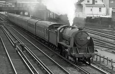 Photo of King Arthur Class 4-6-0 30782 on a Waterloo to Basingstoke train passing Wimbledon in 1962