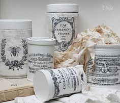 Storage tins. Could also use oatmeal containers or Pringle cans.