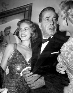 Marilyn with Lauren Bacall and Humphrey Bogart at the premiere of How To Marry a Millionaire, 4 November 1953.