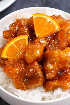 Orange Chicken Recipe {Panda Express Copycat} - TipBuzz Orange Chicken has sticky and crispy fried chicken thighs coated in a citrus, sweet and savory orange chicken sauce. The chicken is marinated and then fried to golden perfection. Orange Chicken Sauce, Chinese Orange Chicken, Baked Orange Chicken, Healthy Orange Chicken, Orange Chicken Crock Pot, Asian Chicken, Crispy Chicken, Mandarin Chicken Recipe Chinese, Gastronomia