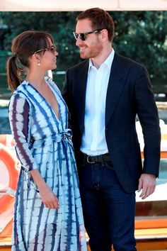 """British actor Michael Fassbender (R) and actress Alicia Vikander pose as they arrive at the Excelsior Hotel to promote the movie """"The Light Between Oceans"""" presented in competition at the 73rd Venice Film Festival"""