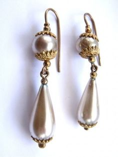 """18th Century earrings - 18th century faux pearl earrings with metal and silver gilt fittings. By the 18th c. – an era when pearls were the perfect accessory to flowing, pastel Rococo fashions – the very best faux pearls were known as ""Roman pearls."" These were hollow beads of blown glass, whose interior surfaces were coated with an iridescent derivative of fish scales."""