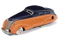 Schuco streamlined turning car, orange/black, working - Miller's Antiques & Collectables Price Guide