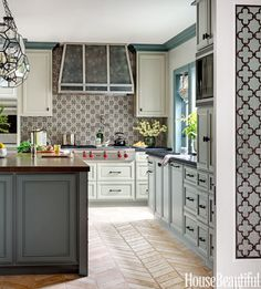 "When designer Annette English revamped a rabbit warren of rooms into an expansive kitchen, she built on the 1937 house's traditional style, then pushed it forward with eye-catching elements. ""I usually do monochromatic backsplashes, but this tile makes a statement,"" English says. The pattern also creates a sense of intimacy in a large room. Windsor Arabia tile from Full Circle Design Studio."