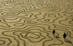 Sand art at Ocean Beach. Stretch a canvas: The formations last only as long as the low tide, and are meant to promote self-aware, and appreciating the beauty of ever...