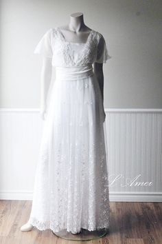 Can you see yourself in this beautiful gown? A gorgeous dress with hours of hand beading on the lace bodice; completely made by hand. The main dress is