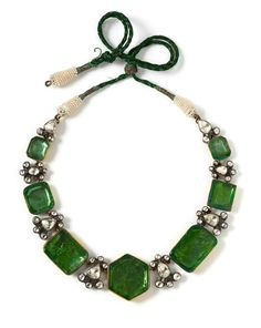 Necklace, India, 1850-1900, with seven foiled emeralds in closed gold settings, separated by diamond clusters in closed silver settings.
