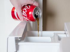 11 Mind-Blowing Things You Can Do with Coca-Cola - The Krazy Coupon Lady Cleaning With Coke, Free Starbucks Drink, Reflux Gastrique, Remove Oil Stains, Cola Drinks, Coca Cola Can, Thing 1, Toilet Cleaning