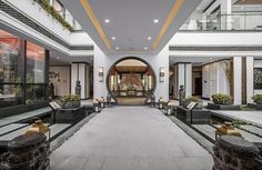 """Lobby area in lakeside Chinese hotel +""""experience"""" center--Built to typical contemporay Western-style format, with traditional Chinese decoration.  1436351717220826.jpg"""