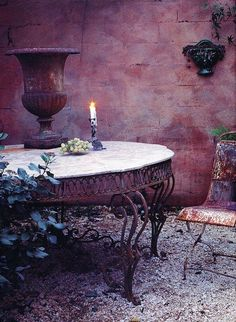 I love everything about this, the wall, table, chair, the rusty urn...