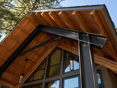 Detail-back porch roof; keep footprint of lower storey small, and large overhanging eaves create relaxing sitting area outside. Steel Frame House, A Frame House, Steel House, Building Design, Building A House, Roof Truss Design, Hgtv Dream Homes, Porch Roof, Screened Porches
