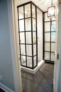 framed glass shower + subway tile shower surround + iron lantern