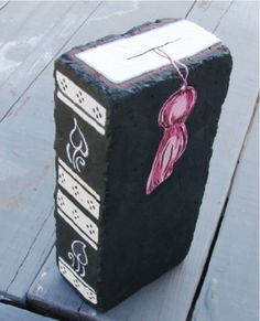 Brick bookend or door stop hand painted brick. $9.99, via Etsy.