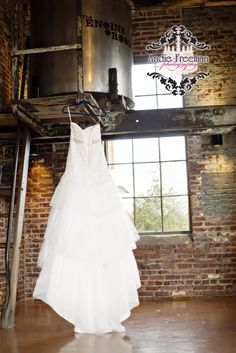Vintage strapless wedding gown with jeweled belt. Designed by Carrie's Bridal Collection. Industrial Winter Wonderland Wedding. Photography: Andie Freeman Photography www.TheAthensWeddingPhotographer.com Event Design, Floral, and Wedding Planning: Southern Sophistication Venue: The Engine Room Catering: Bleu House Cafe Makeup: Bombshell Creations www.bombshellcreations.com
