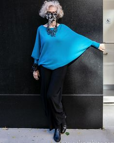Batwing sleeve top worn with black pants, booties and accessories | For more style inspiration visit 40plusstyle.com