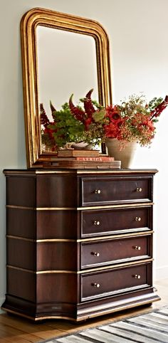 From its scalloped corners to the handpainted gold leaf highlights above its four ample drawers, the Greenwich Chest has a powerful presence.  | Frontgate Interiors