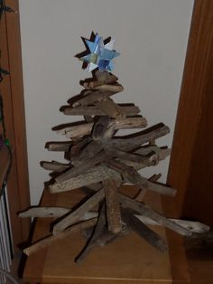 This is a tree we made from driftwood we beach-combed off our beaches on Kodiak Island Alaska.  We make each tree unique as each piece of