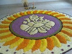 Rangoli is the best way to bring life to your homes during a festival. Here are some Ganesh rangoli designs for you to try in 2019 to enlighten your house Rangoli Designs Flower, Rangoli Designs Diwali, Rangoli Designs With Dots, Flower Rangoli, Beautiful Rangoli Designs, Best Rangoli Design, Onam Pookalam Design, Ganesha Rangoli, Decoration For Ganpati