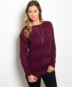 This relaxed fit open knit sweater is a must have for every girl! The Very Berry boutique sweater comes in a gorgeous light and dark shade of Berry, long sleeves for warmth, a round neck line, thick l