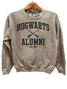 Hogwarts Alumni Simple - Sweater   Available sizes for this listing are Small, Medium, Large, Extra Large, 2XL, 3XL. All sizes are standard sizes.  Crew Neck sweatshirt Image is sublimated onto the 50% cotton 50% polyester blend sweatshirt. The image will fade after first wash but should keep its color after that.  50% cotton, 50% polyester pill-resistant air jet yarn double-needle stitching throughout set-in sleeves 1x1 ribbed collar, cuffs and waistband with spandex  Available colors for…