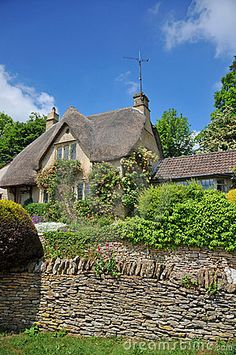 Cottages Houses:  A traditional thatched-roof cottage in rural England