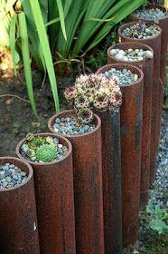 Steel pipe, gravel & succulent garden edging.