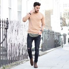 Try pairing a beige crew-neck sweater with black destroyed skinny jeans for a…
