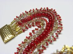 Hand Bracelet, Crochet Knitting, 7 lines of Glass beads, Shining Red, Gold, Hand Made, cotton strings Gold Plated rings and Clasps.