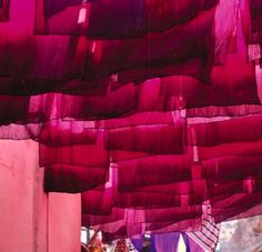 Beautiful: bold magentas bleeding into bright pinks!  carpets drying: Selvedge, issue 17