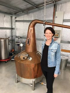Anne from Tasmanian Whisky Academy pictured with Pandora, our copper pot still #still #distillery #distillerytour