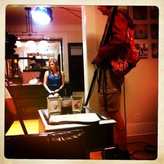"""Chelsey Crisp waits on the set of """"Madchen"""", Michael Schachtner in foreground with audio gear"""