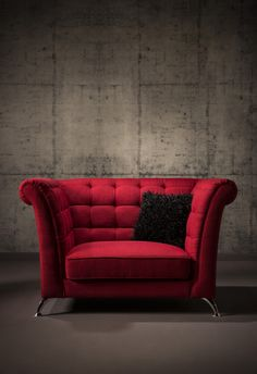 "Turn tradition on its head with a fiery red Rosey 88"" Sofa. Taking inspiration from the Chesterfield style and granting a tuxedo back, this is modern at its best. This stylish sofa provides upholstery in polyester and cotton in addition to flared arms, tufted accents, and metal legs your rooms will be delighted. Two pillows are included as shown."