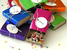 Match stick boxes covered in foil wrap - What a great way to hand out confetti for party-goers to throw at midnight.