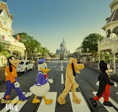 """One of the most iconic photos of The Beatles was taken in 1969 for the group's """"Abbey Road"""" LP. The album cover showed John, Ringo, Paul and George (walking in that order) in mid-stride on an Abbey Road crosswalk in London.  To honor the band's 50th anniversary, we asked Mickey, Pluto, Donald and Goofy to recreate the photo on Main Street, U.S.A., at Magic Kingdom Park."""