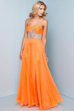 "Start out searching for your perfect long maxi strapless orange prom dress by flipping through magazines and online to see what kind of dress you are most attracted to. Then hit the stores with an idea in mind of what you are looking for. Try on as many dresses as you can; your idea of the ""perfect dress"" may not be as well suited for you as another style. Don't limit yourself."