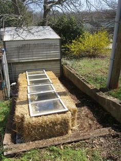 Have some old windows to repurpose? Get a few straw barrels and you've got yourself a cold frame!