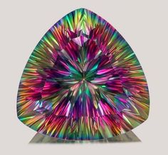 Mystic topaz (natural colourless -white- topaz that has been coated, giving it a unique rainbow colour effect. Therefore, it is not a gem type, but is an enhanced clear topaz. )~~~ and still pretty