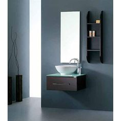 This Valerie bathroom vanity set is a single drawer with a side cabinet for additional storage. The vanity is constructed from eco-friendly solid rubber wood construction and comes complete with the mirror, shelf, basin and faucet.
