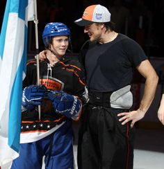 ANAHEIM, CA - FEBRUARY 5: Leevi Selanne, left, poses with his father, Teemu Selanne of the Anaheim Ducks to show he will represent Finland in the upcoming Olympics on February 5, 2014 at Honda Center in Anaheim, California. (Photo by Debora Robinson/NHLI via Getty Images)