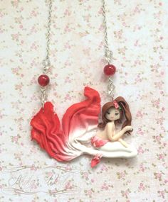 My red and white #mermaid, one of my last chibis and a unique model as it took more than 3 hours to make it.     Click now to get this one for 23€ or contact me to get your custom mermaid !  You can also order your very own creation or just a #custom version of an already existing one #EtsyCustom  ****************************************  Get 10% #OFF with the #promo #code 2016SALES . #soldes #sales  ****************************************