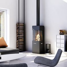 - Holz-kaminofen / modern / 3 sichtseiten / metall by RAIS Contemporary Wood Burning Stoves, Modern Stoves, Living Tv, Home And Living, Modern Living, Indoor Wood Stove, Freestanding Fireplace, Firewood Storage, Stove Fireplace