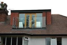 Dormer window with French doors and balcony
