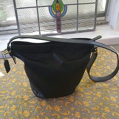 Buttery Soft Coach Bucket Bag This leather is as smooth as a baby's rear! Gorgeously soft and supple. It is black with one interior pocket that zips. Wardrobe staple must have! Bags Shoulder Bags