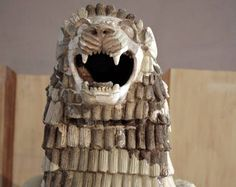 A Babylonian (2000-1500 BC) pottery lion which decorated the main temple in the Tell Harmal is on display during the opening ceremony of the Iraqi National Museum.