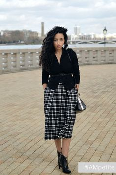 """""""This monochrome plaid midi skirt is so versatile and stylish, and the pockets add an extra chic touch. A must have for any fashionista!""""- Miss Everyday Elegance As far as we're concerned, petite girl"""