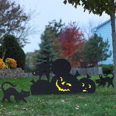 Scare the neighborhood this Halloween by creating an eerie scene on your lawn with silhouette creatures made from plywood.