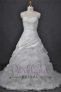 http://www.parklandbridal.co.nz/Store/tabid/4393/ProdID/33799/CatID/358/Parkland_Bridal_Clarissa.aspx  A beautiful sweetheart neckline gown with beautiful lace and beading. Features a beautiful ruched and caught up skirt.