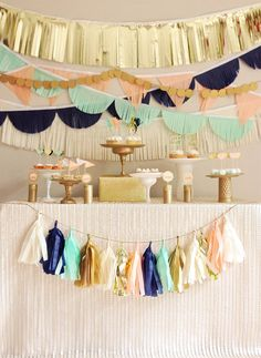 This tissue garland set is a modern, graphic, cool and glam addition to your next event! Mint, peach, navy, off-white, shiny gold and matte