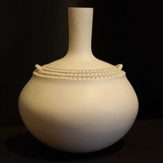 Long neck vase with corregated detail