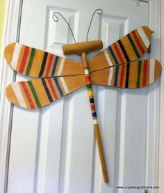 """Croquet Mallet Dragonfly: For this one, I drilled two holes through the wings and mallet, inserted a machine screw and attached with a wing nut in the front. I even used the wickets that came with the set to make the antenna, I drilled two holes through the """"head"""" of the dragonfly and inserted the wire wicket... I gave them a little curl at the top with pliers."""
